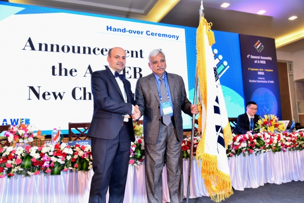 AWEB Flag being handed over to the new Chairman, CEC Sunil Arora by the Representative of Outgoing Chair, Mr. Ion Mincu Radulescu, Advisor, Permanent Election ACEC